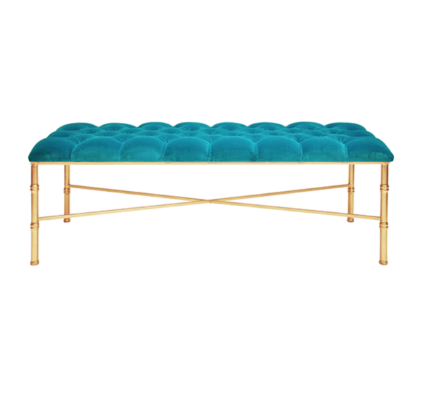 Turquoise velvet bench with gold leaf legs.