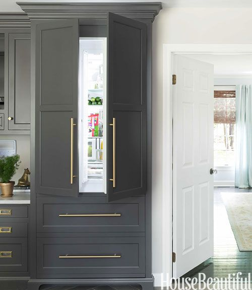 Stylish refrigerator disguised as part of kitchen cabinets.