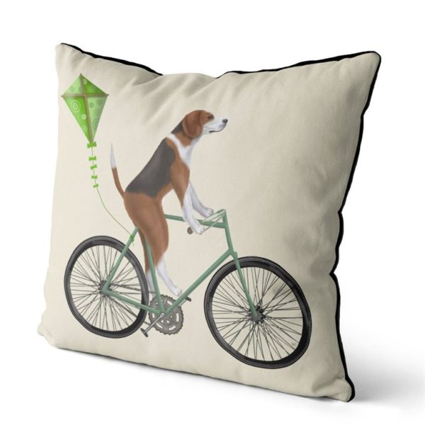 Beagle on bicycle with a kite