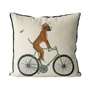 Boxer on bike pillow cream background side