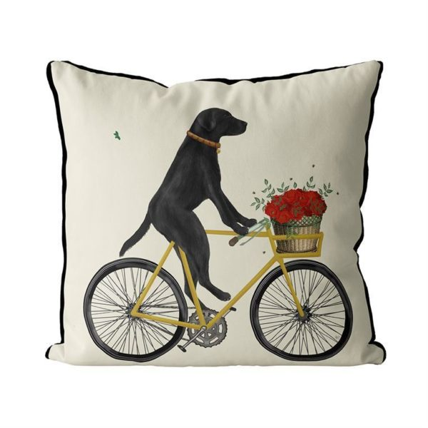 Black Lab on Bike Pillow with cream background front