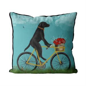 Black Lab on Bike Pillow with sky background front