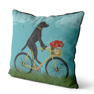 Black Lab on Bike Pillow with sky backround