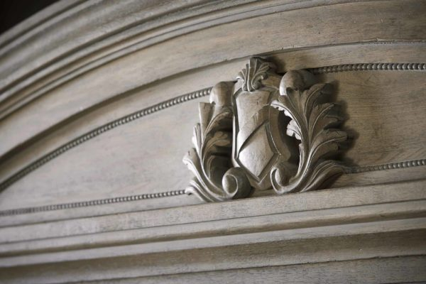 Acanthus Shield on headboard closeup