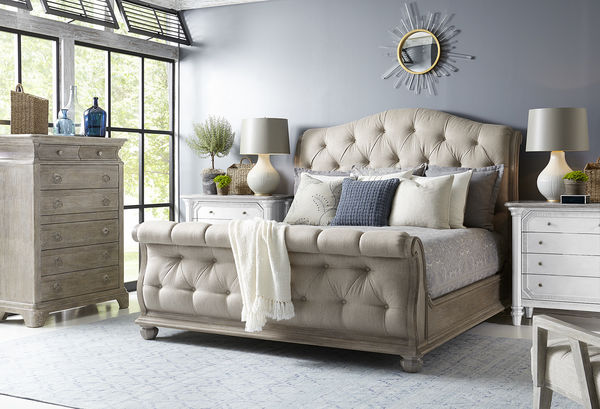 Cottage Tufted Sleigh Bed in a blue room