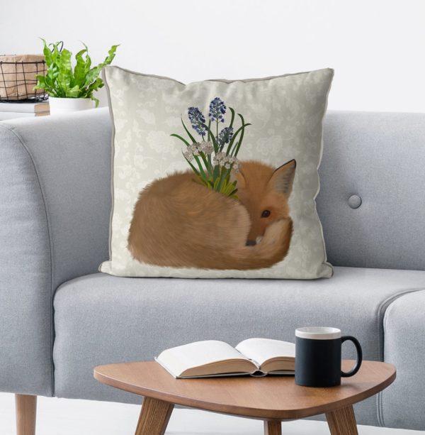 Sleepy Fox pillow on the sofa